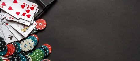 Gambling flat lay.Close-up cards for playing poker on a gaming table in a casino against a background of chips.