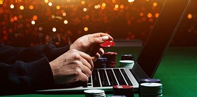 Person playing online poker and looking winning cards.